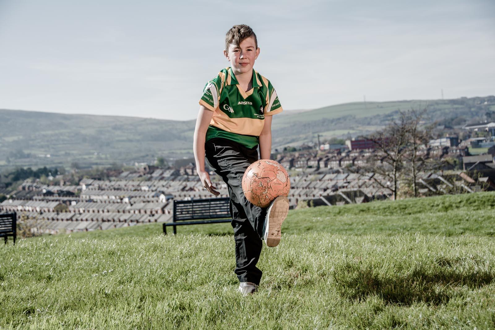 Boy wearing GAA top in park - photo 5334 by Stephen S T Bradley photographer Dublin and Belfast, Ireland