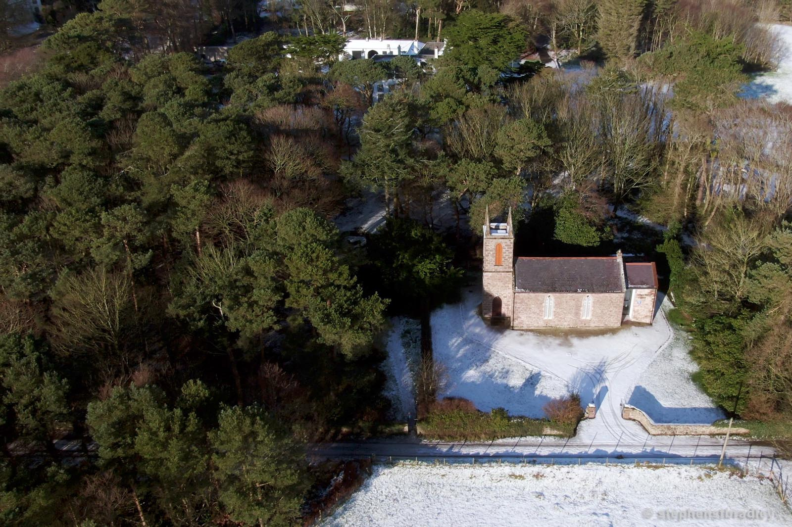 Aerial drone photography and video production services Dublin and Ireland portfolio - Cushendun village under snow in winter, video screenshot 1