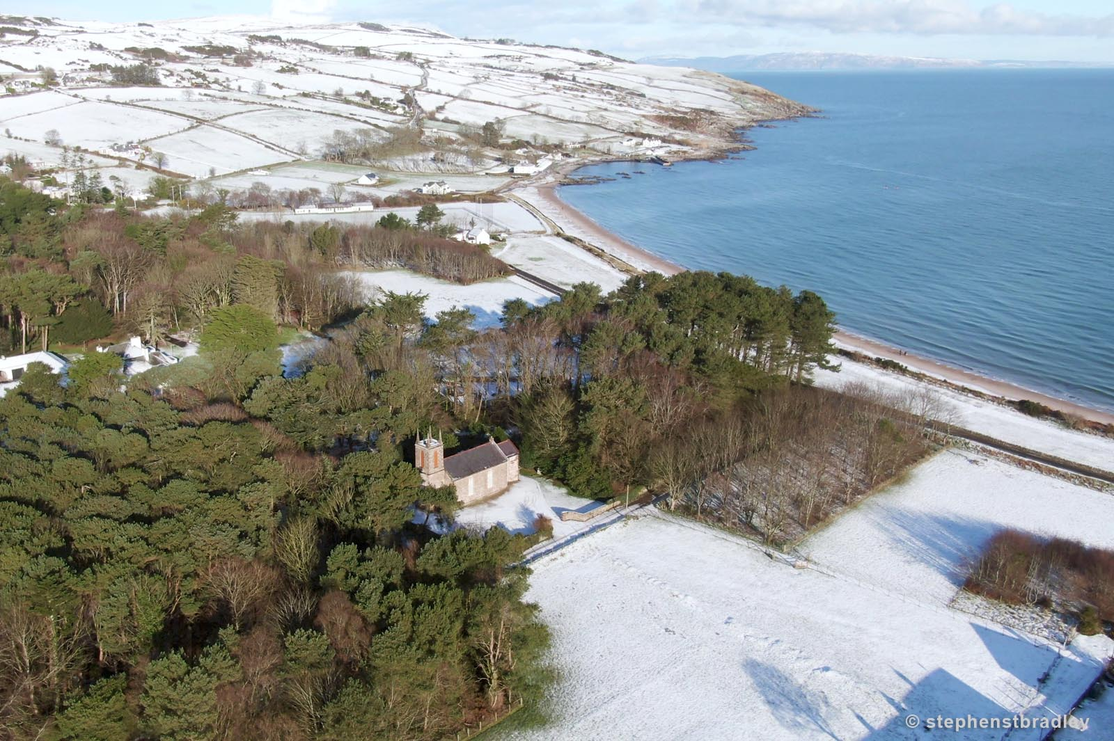 Aerial drone photography and video production services Dublin and Ireland portfolio - Cushendun village under snow in winter, video screenshot 2