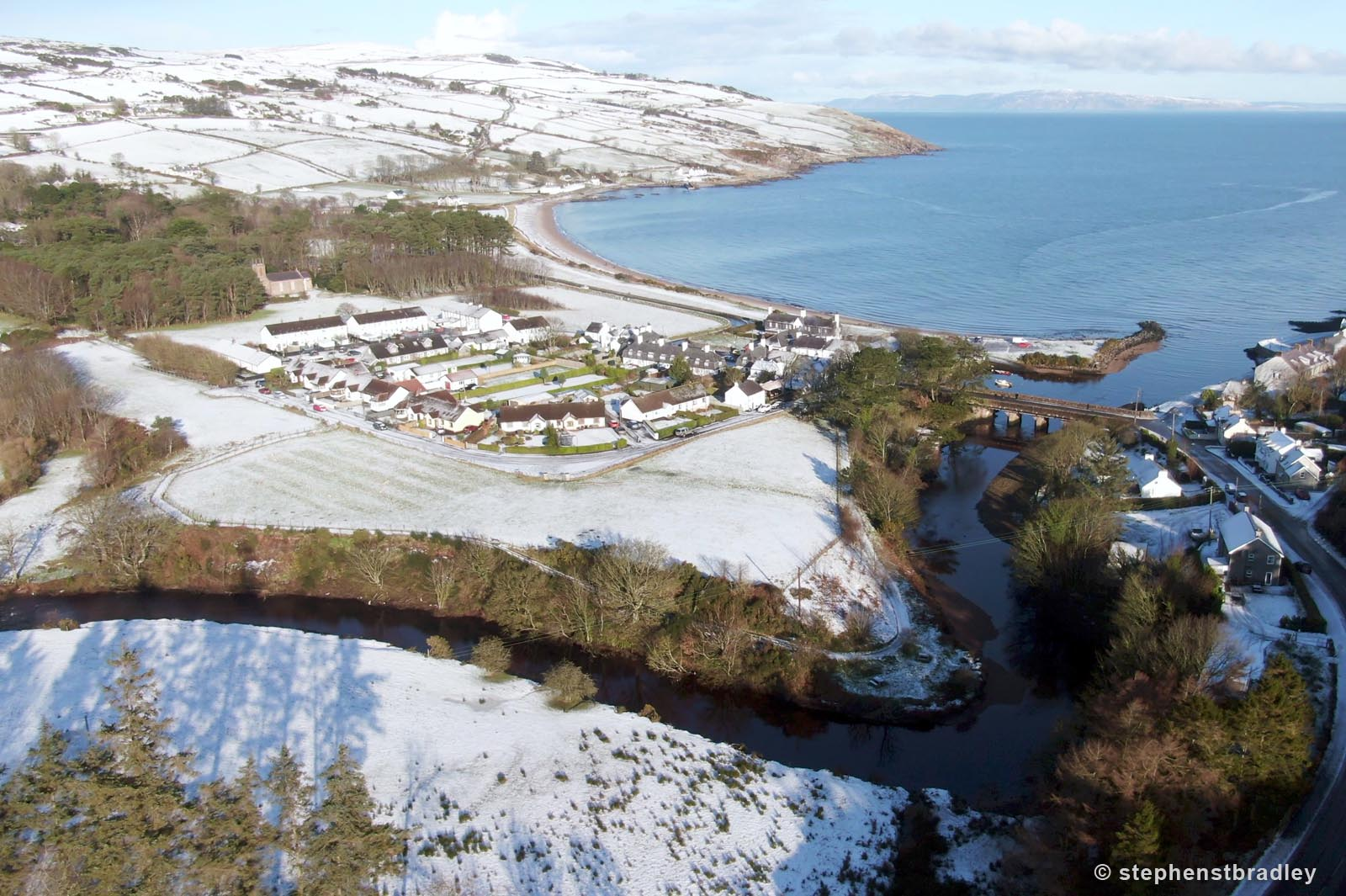 Aerial drone photography and video production services Dublin and Ireland portfolio - Cushendun village under snow in winter, video screenshot 3