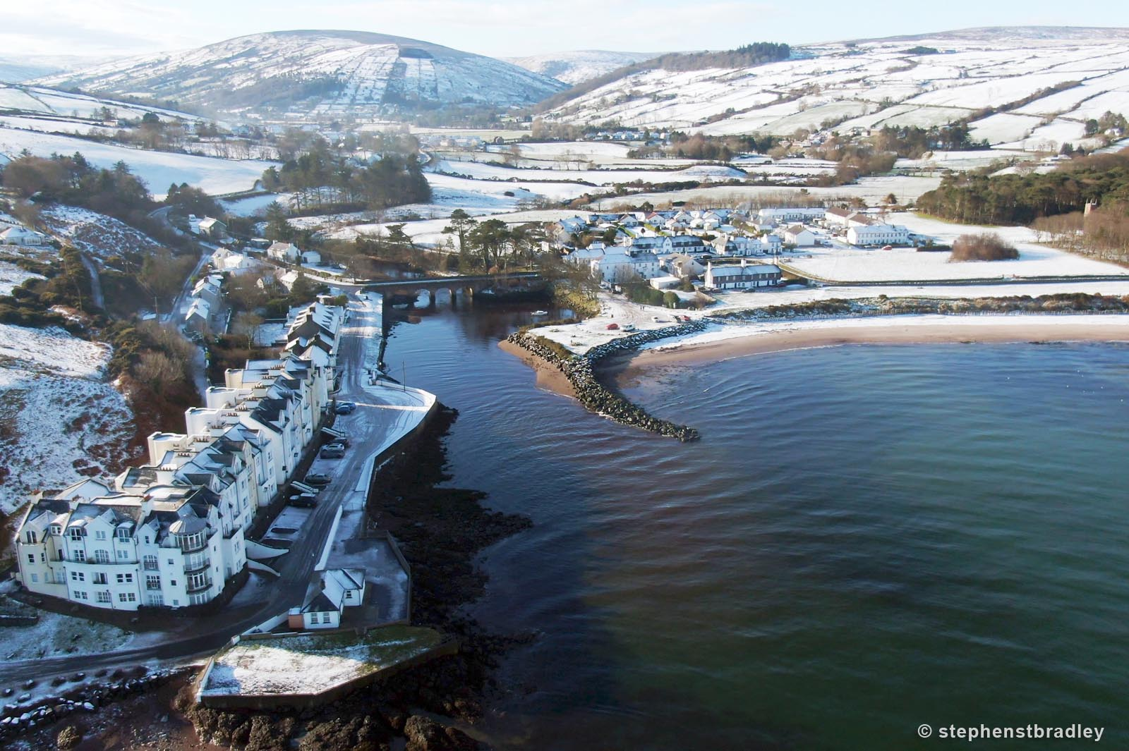 Aerial drone photography and video production services Dublin and Ireland portfolio - Cushendun village under snow in winter, video screenshot 5