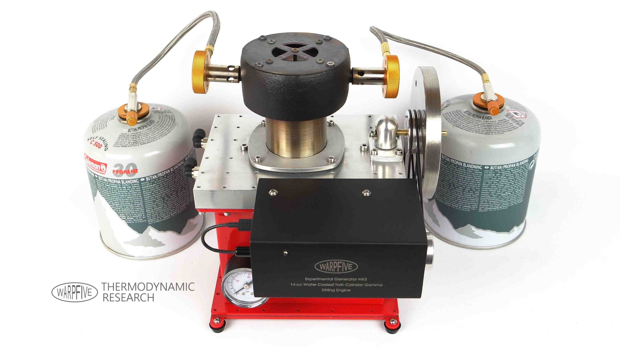 Warpfive 14cc water-cooled twin cylinder Gama experimental generator powered by camping gas through an annular burner for off-grid use