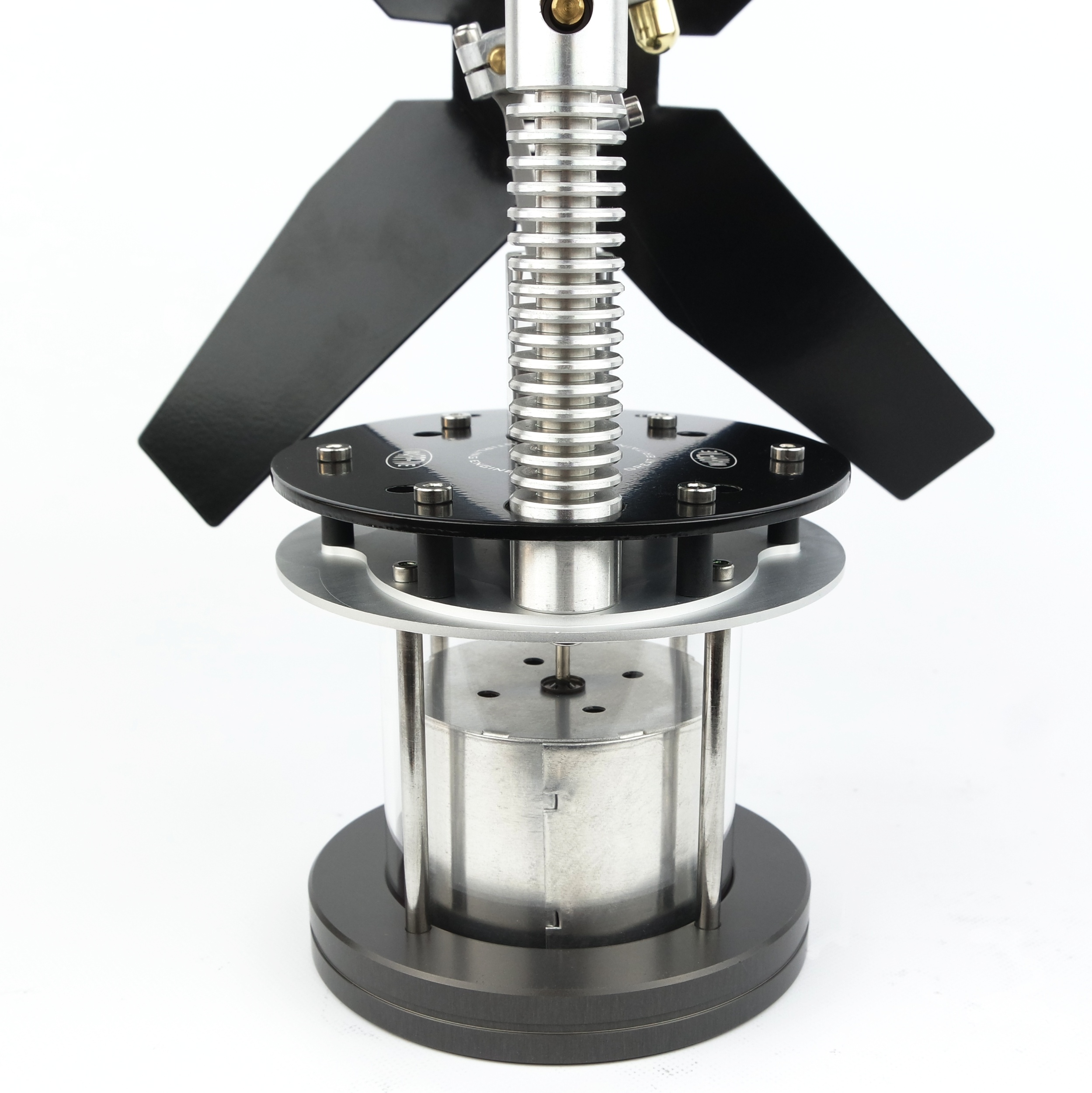Clear glass cylinder shows working displacer in the Glasshopper Stove Fan