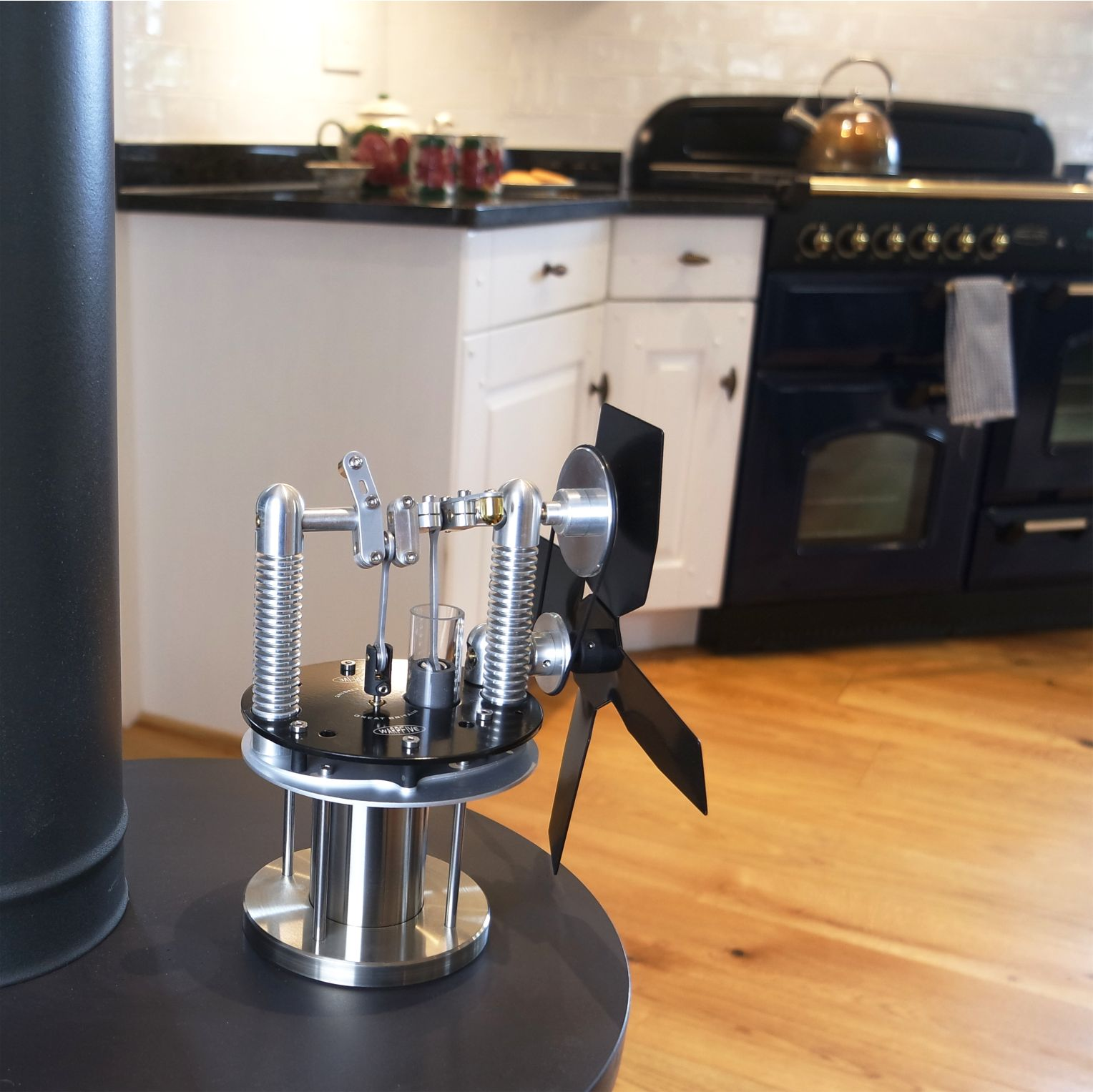 Small stove fan with complex Stirling engine design. Operates across a broad range of temperatures