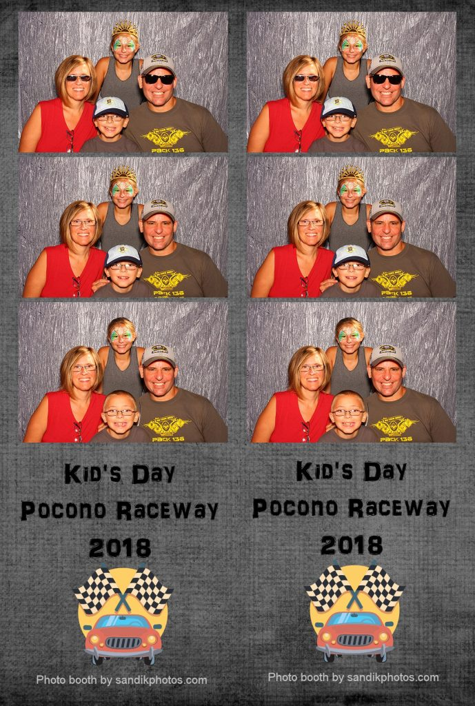 family having fun in a photo booth