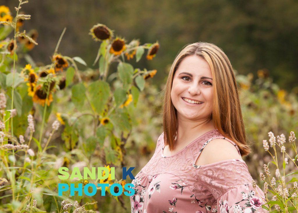 senior pictures in sunflower field
