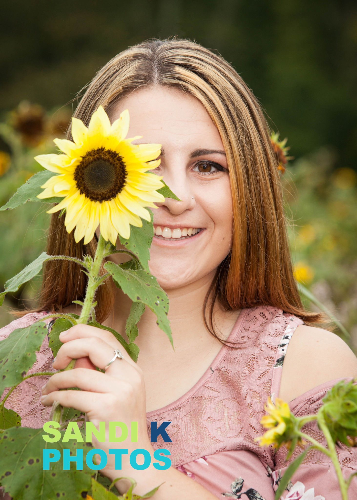 senior picture with sunflower