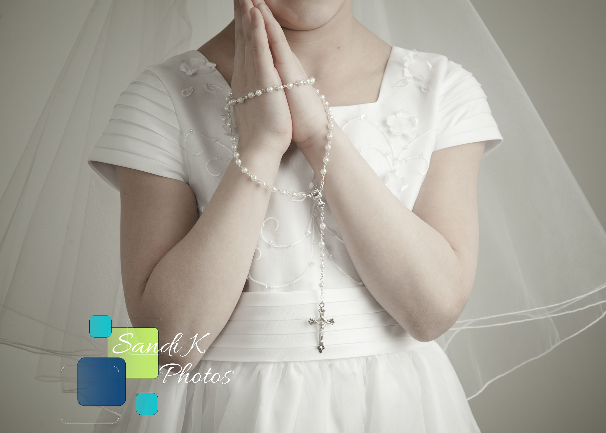 girl holding rosary for first holy communion photos