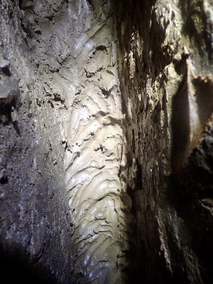 Fingermarks in the clay. The miners would use the clay to hold candles in the side walls of the passages.