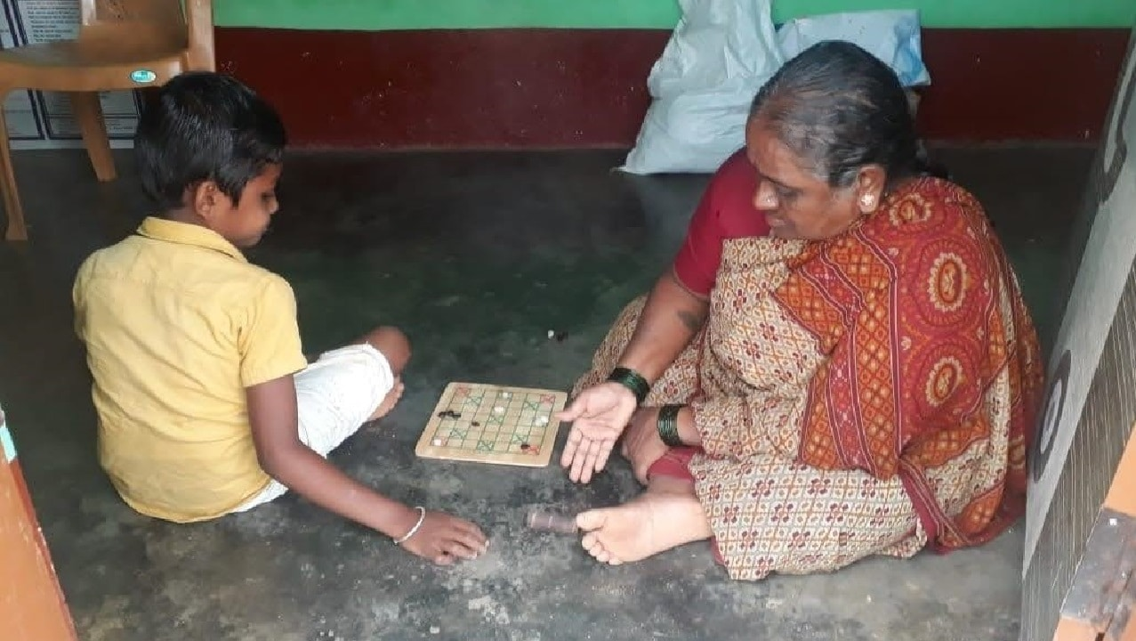 Playing board games with the family members