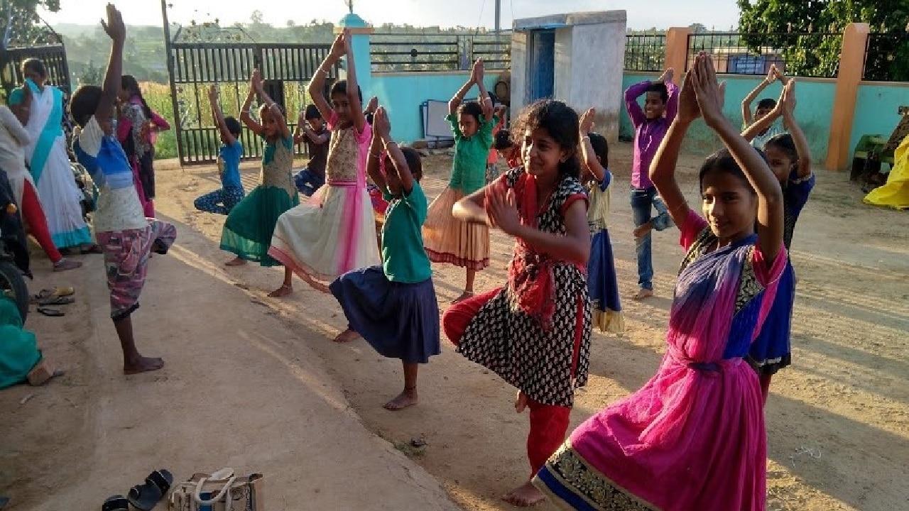 Children performing Yoga
