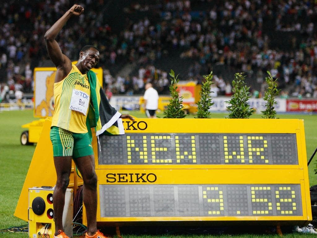 Usain Bolt of Jamaica celebrates winning the gold medal in the men's 100 Metres Final at the World Athletics Championships in Berlin on August 16, 2009. He set a new World Record of 9.58.
