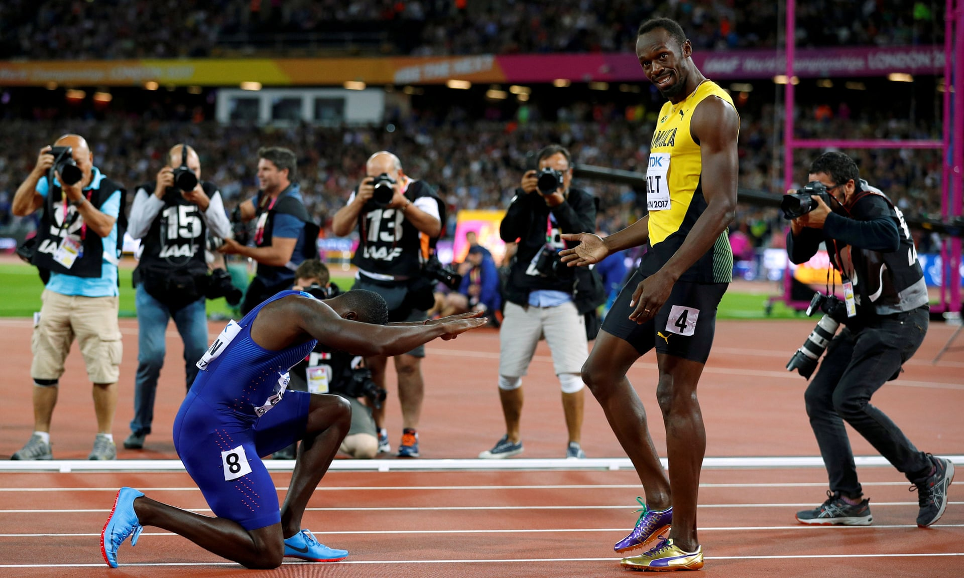 Justin Gatlin bows before Usain Bolt after beating him in the 100m final.