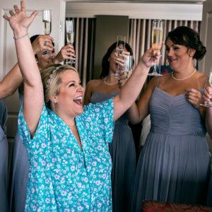 bride and bridesmaids toast at hotel zaza houston