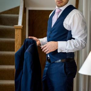 groom in blue 3 piece suit