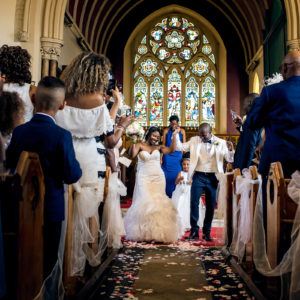bride and groom dance up the aisle