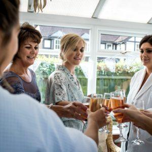 Bride and bridesmaids toast