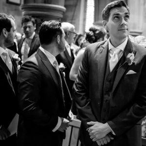 groom waiting at the front of the church