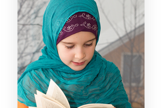 kid-reading-quran-outside