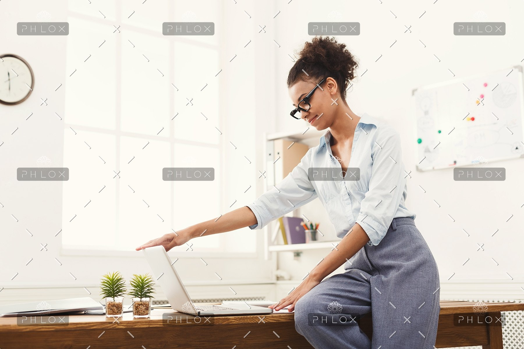 demo-attachment-505-business-woman-opening-laptop-at-office-PU4ZAGW