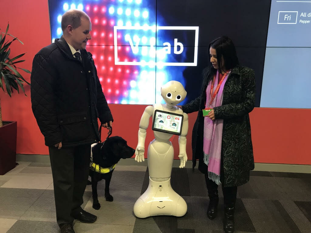 Graphic: Two researchers with robot