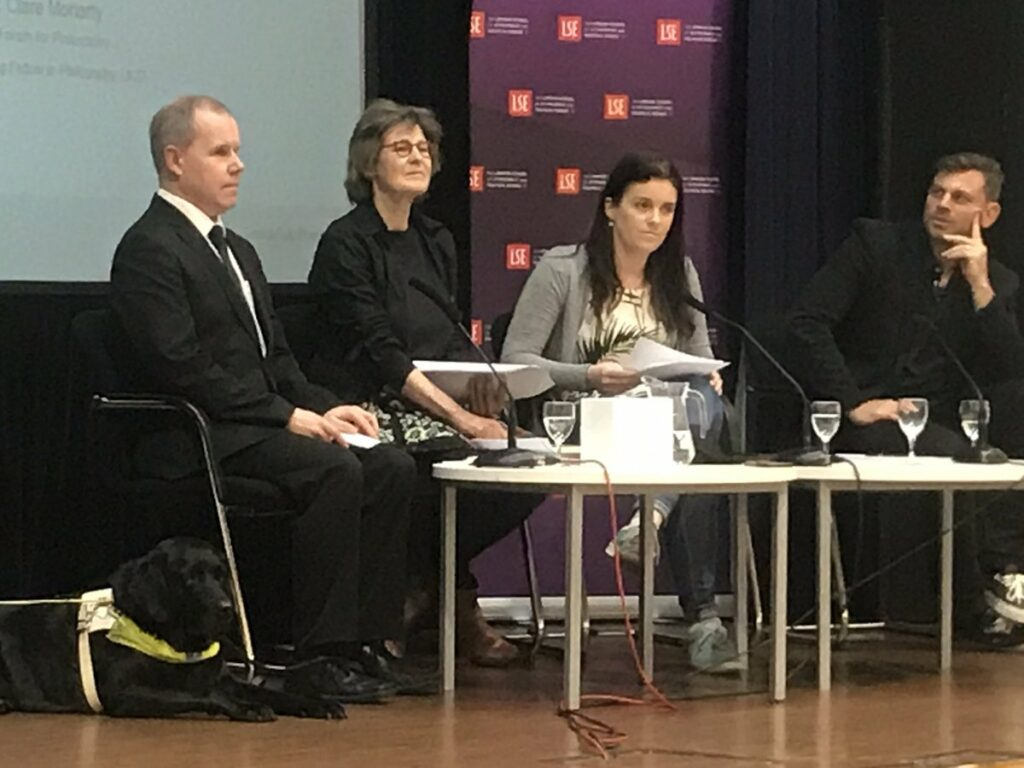 Picture of Barry Ginley and Guide Dog, Marjolein Degenaar, Clare Moriarty and Brian R Glenney on stage at the LSE