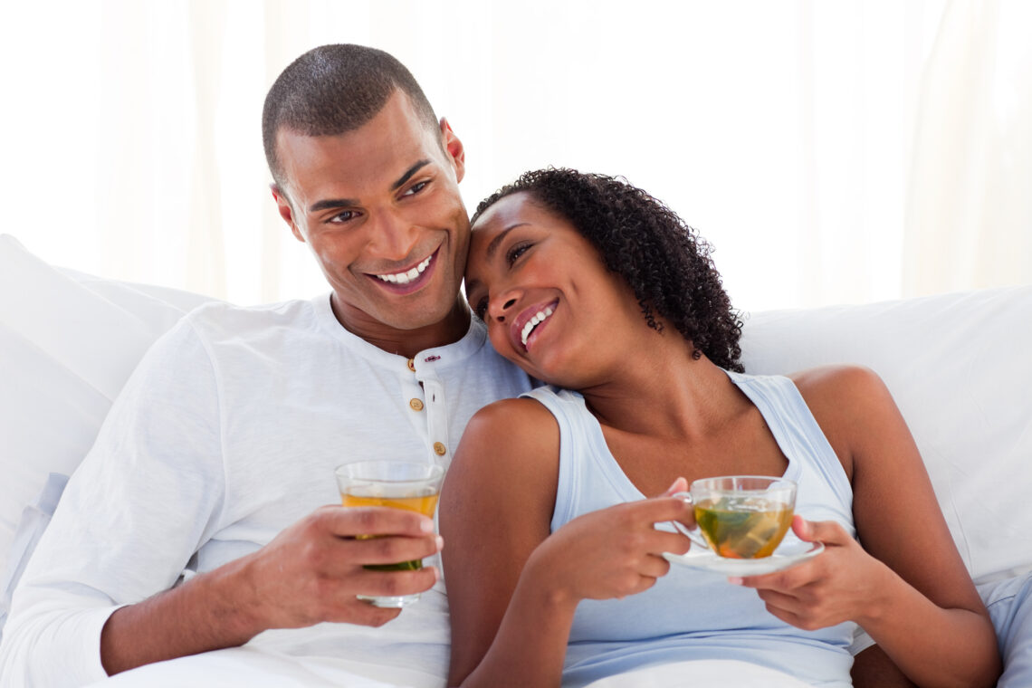 photodune-8162584-happy-ethnic-couple-drinking-a-cup-of-tea-on-their-bed-m