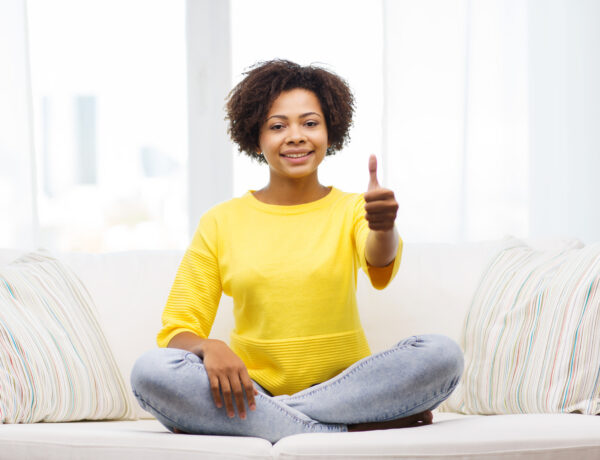 happy african american young woman at home