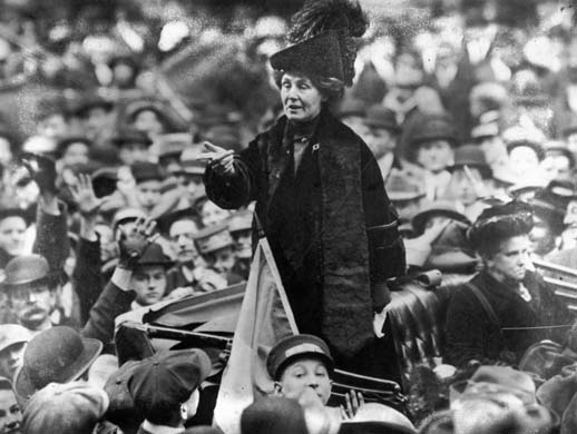 circa 1911: British suffragette Emmeline Pankhurst (1858 - 1928), being jeered by a crowd in New York.