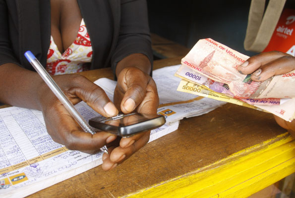 MTN mobile money withdraw charges mobile money in Uganda