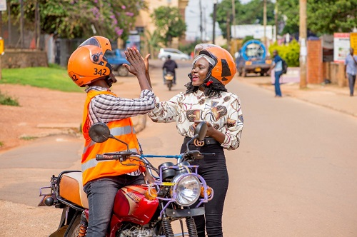 SafeBoda rider and customer high-fiving safeboda 50% off rides