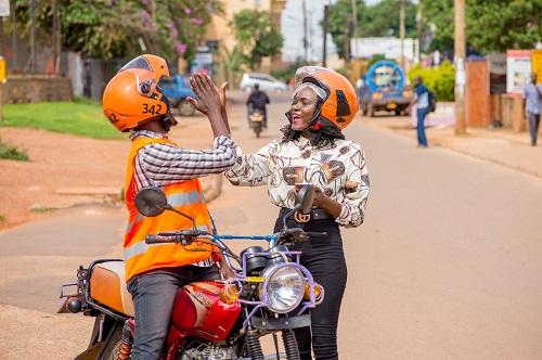SafeBoda rider and customer high-fiving safeboda 50% off rides