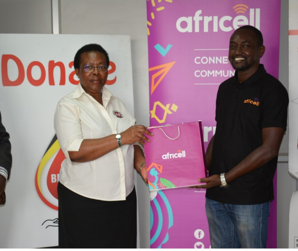 Dr_Dorothy_Nakyeyune UBTS Executive_Director_Receives_Donation_From Africell PRO Edgar Karamag