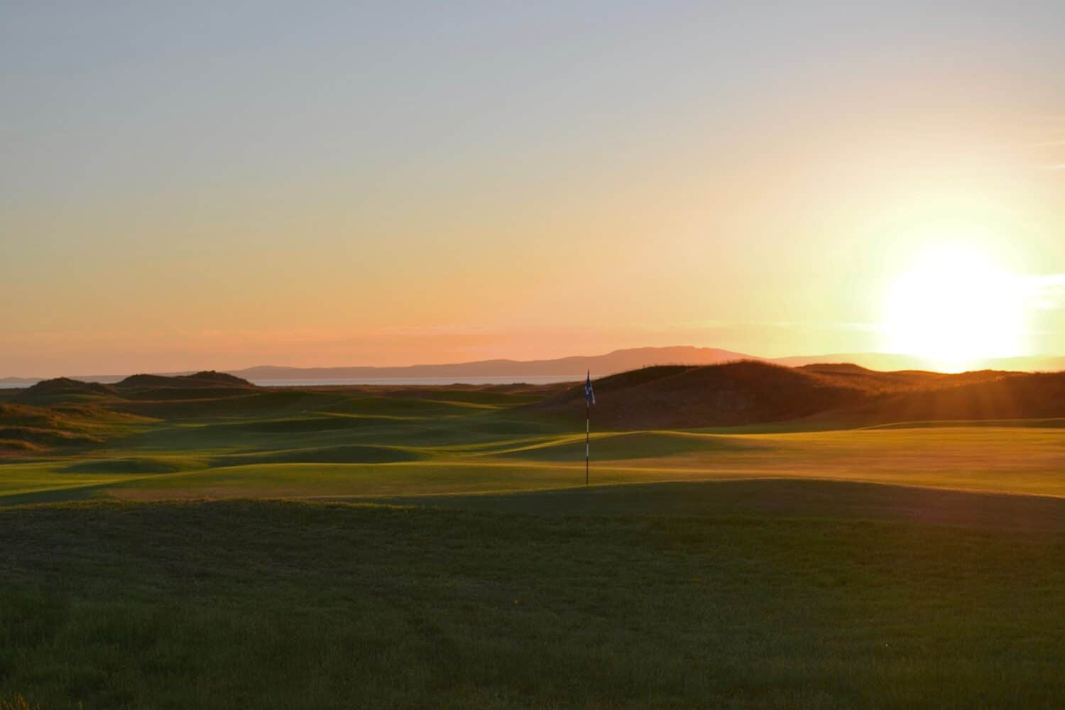 Sunset over the 18th green at The Machrie
