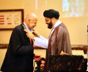 Maulana Sayeed Adeel Reza, Resident Alim of Dar es Salaam Jamaat, bestowing Husseini Medal on Alhaj Pyaralibhai Shivji in Dar es Salaam Imambargha