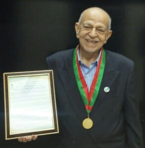 Alhaj Pyaralibhai Shivji with Husseini Medal and Citation.