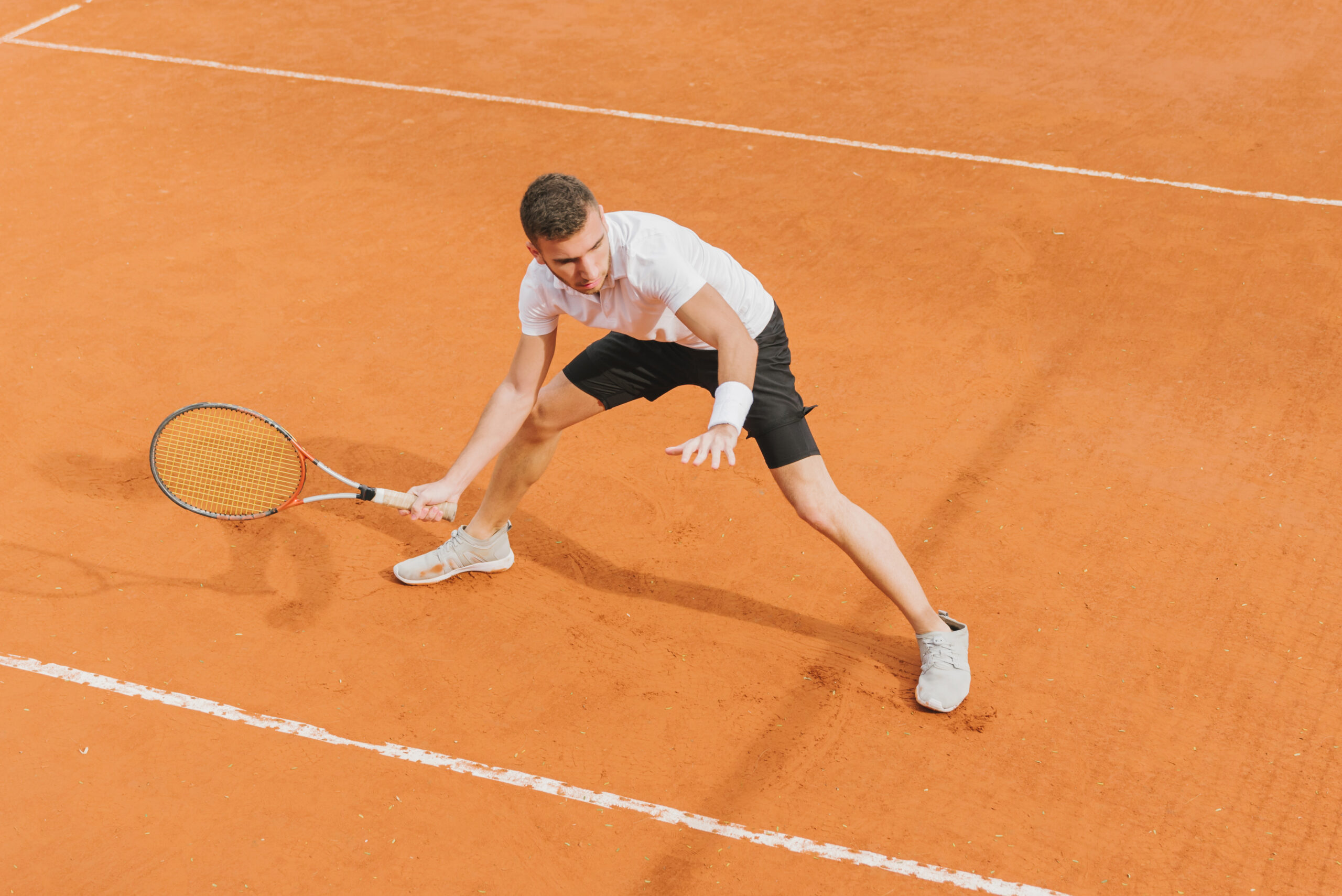athletic-young-boy-playing-tennis