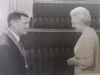 Lex Gold receiving his CBE from The Queen