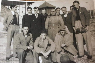 Bournemouth Gasworks Athletic Fin their work clothes before a match in the 1950'sootball Team