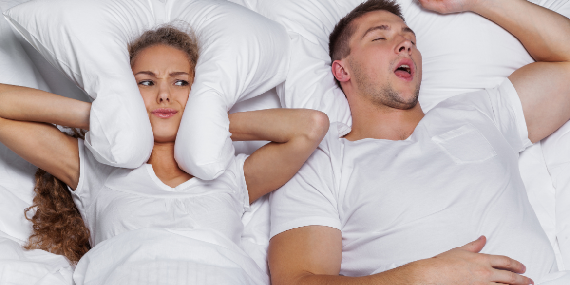 woman sleeping with a man who snores