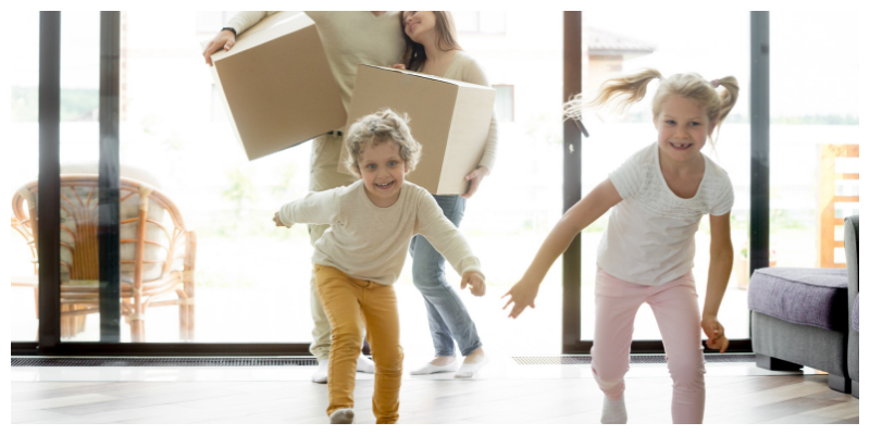 Young family moving into their new house.