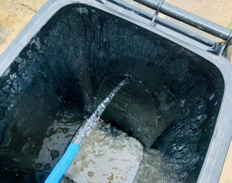 cleaning a wheelie bin
