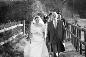 The long church path provides a beautiful approach for the bride (© Scott Ramsey Photography)