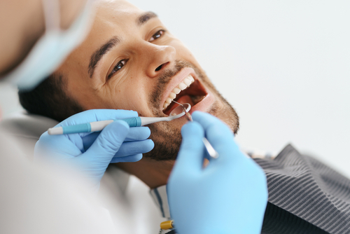 man getting his teeth checked