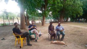 Sam Lumborg relaxing with locals with Ethiopia.