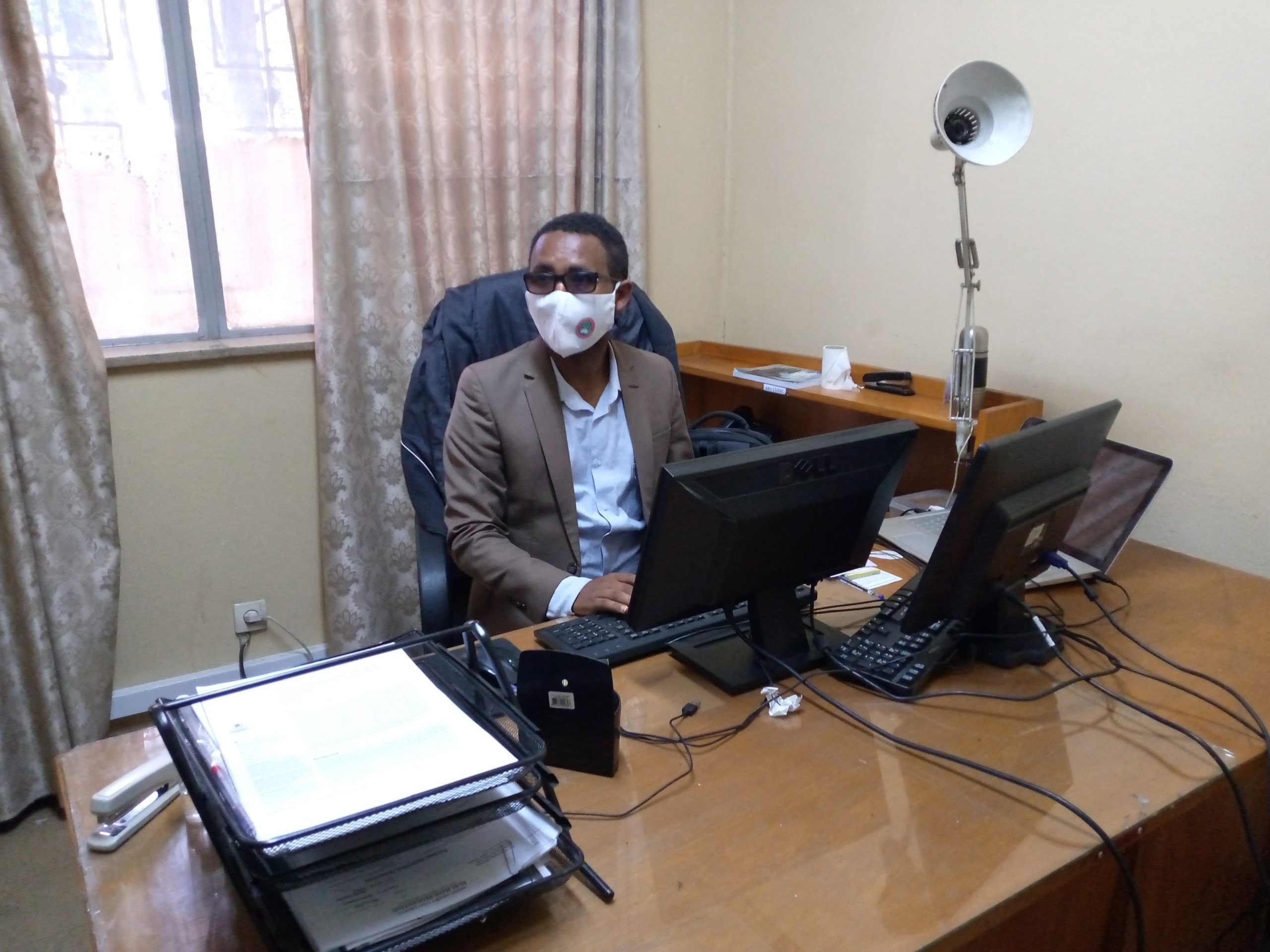 Tilahun in his office