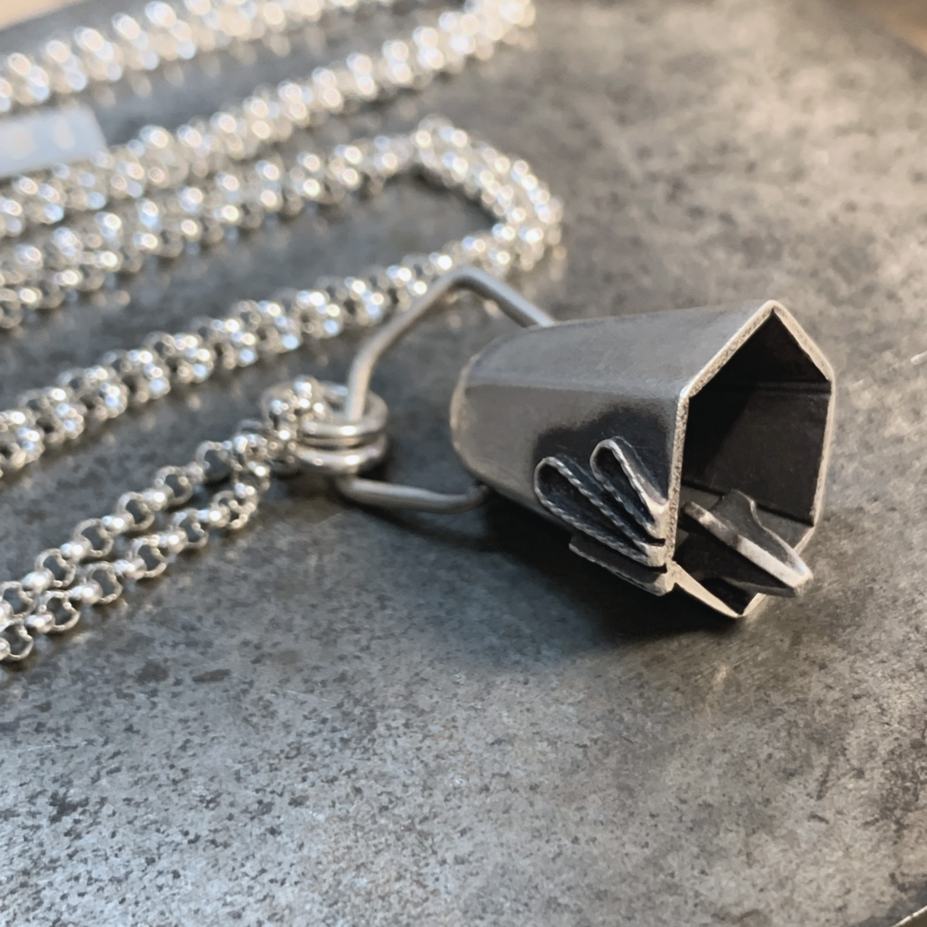 Kinetic silver bell necklace