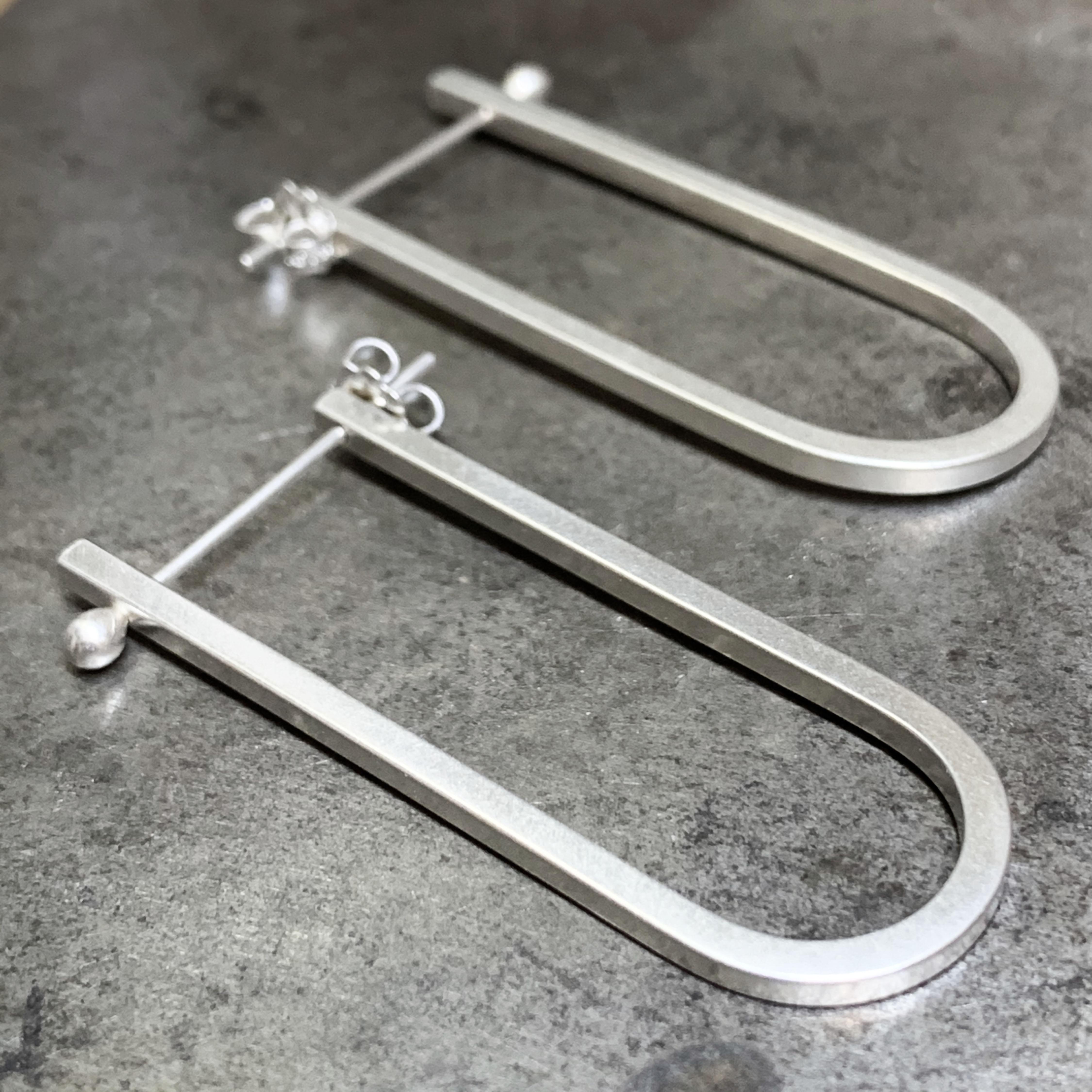 U-shaped silver earrings