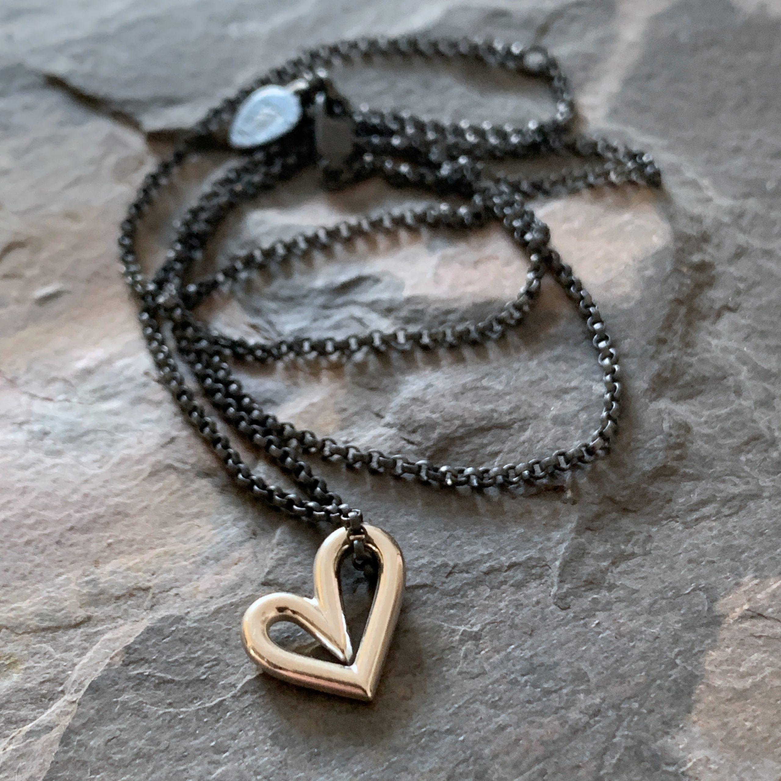 Heartbeats floating asymmetrical heart necklace