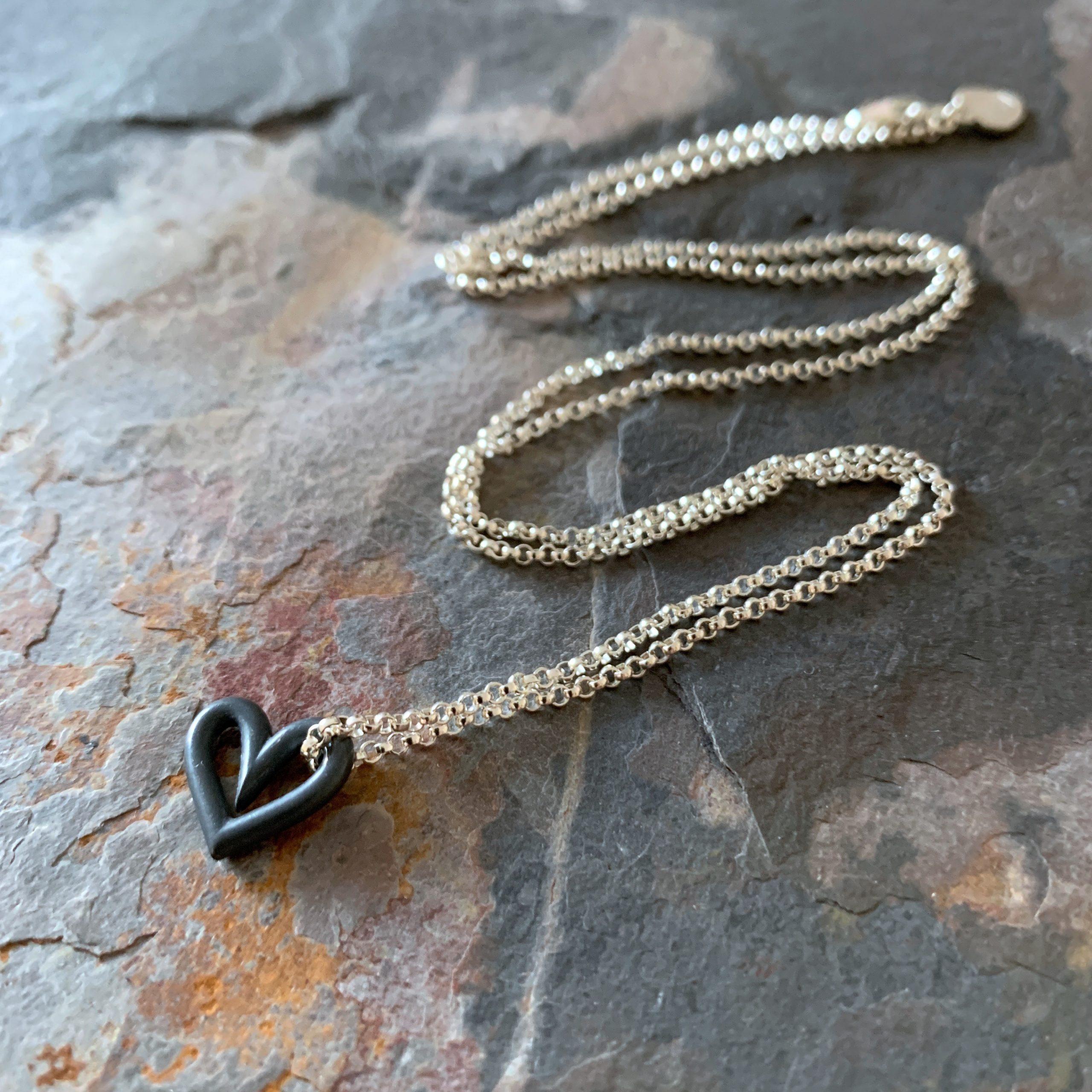 Heartbeats floating symmetrical heart necklace